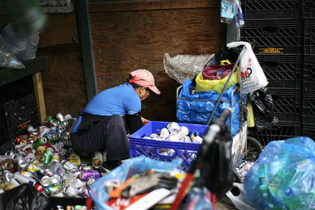 An informal recycler sorts aluminum cans at Sure We Can in Brooklyn, New York. (Carlos Rivera)