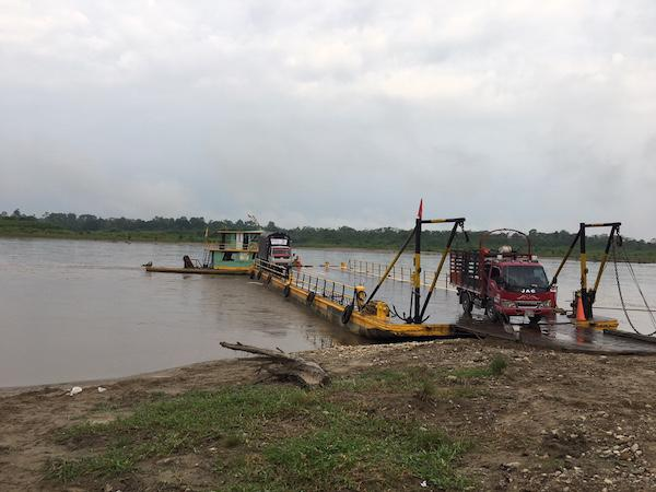Ferries and smaller canoes travel across the Putumayo River to get to demobiilzed zones. (Photo by Winifred Tate)