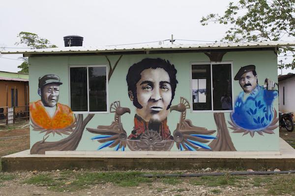 Over the past year, FARC members living in zones designated for integration into Colombian have painted their homes with colorful murals. (Photo by Winifred Tate)