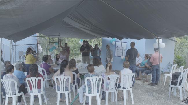 Mark Baker, Water Mission; Juan Santana, La Riviera; and members of the La Riviera community (Photo by Leando Fabrizi)