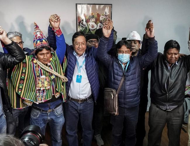 Luis Arce Catacora celebrates following the victory of the MAS party on October 18, 2020 in La Paz, Bolivia. (Marcelo Pérez Del Carpio)