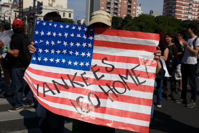 """A protester carries a sign reading """"Yankees go home!"""" during a rally protesting the 2018 G20 summit in Buenos Aires, Argentina. (Photo by Montecruz Foto)"""