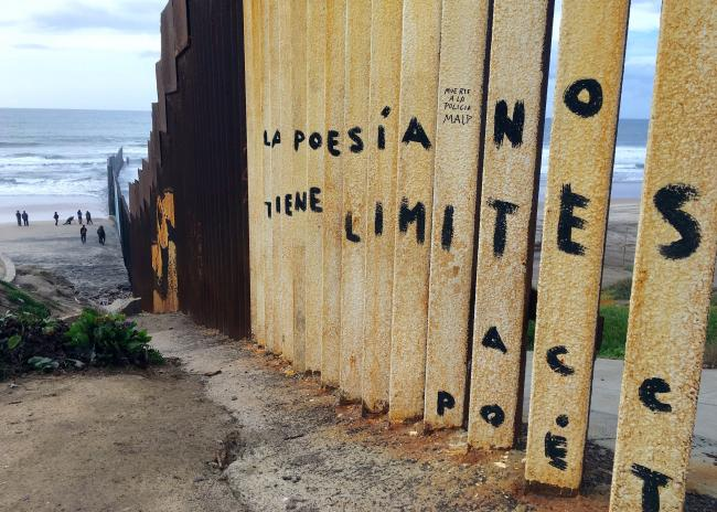 At the already existing border fence that divides Tijuana, Mexico, from Imperial Beach, California. (Photo by Katie Schlechter)