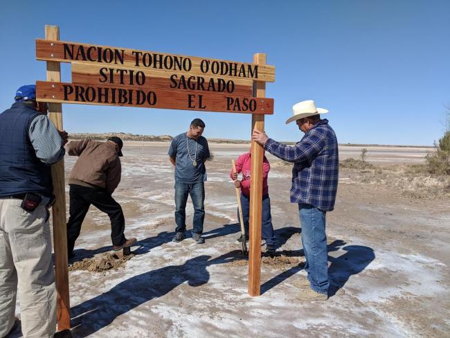 "O'odham salt runners and local landowners erect a sign at the salt flats that reads: ""Tohono O'odham Nation, Sacred Site, No Trespassing."" (Tohono O'odham Men's Salt Pilgrimage)"