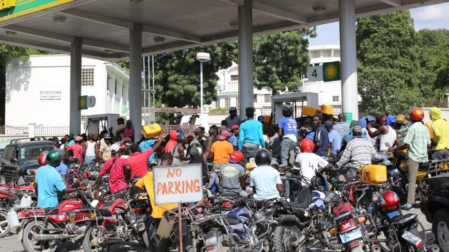 Motorcycle taxi drivers waiting for a gas delivery (Photo by Paul Jean Emile)