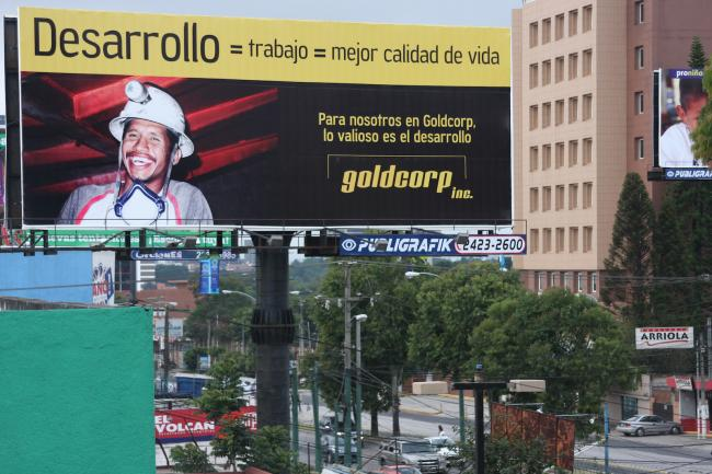 """A Goldcorp billboard posted in Guatemala City during a heavy propaganda campaign in 2008 -2009. The sign reads: \""""Development = work = better quality of life. For us at Goldcorp, development is the most valuable.\""""  (Photo by James Rodriguez)"""