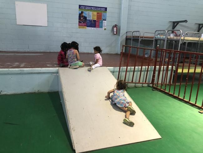 Girls from Mexico and Central America play together in a refugee shelter along Mexico's Northern border in February 2021. Though their families have fled their homelands for similar reasons, they do not have the same protection under U.S. law.