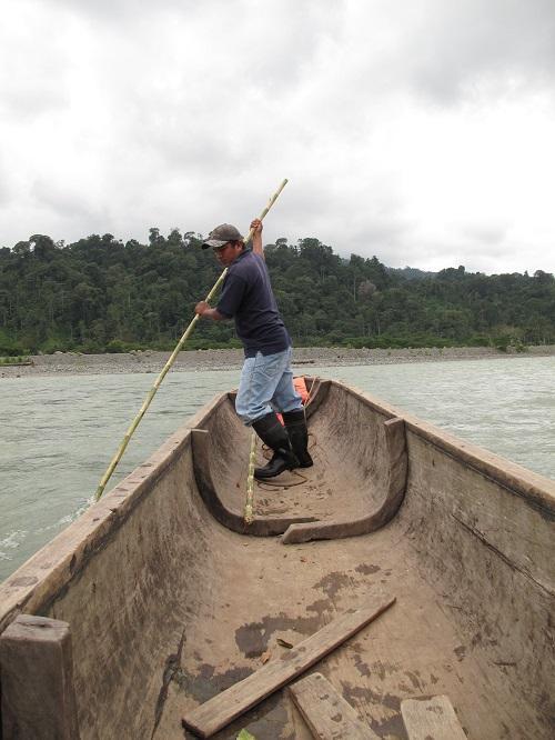 A Naso boatsman on a cayuco (dugout canoe) on the Teribe River. (Richard Arghiris)