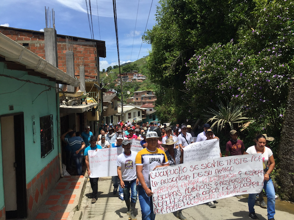 "Campesinos march to protest the murder. The sign reads: ""Cucurucho feels sad because of the absence of its friend Gabriel Angel Rodriguez and waits for a public apology and true responses about what happened from the National Army."" (Photo by Alex Diamond)"