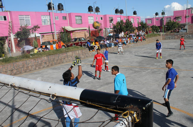 A soccer game in the community (Photo courtesy of OPFVII)