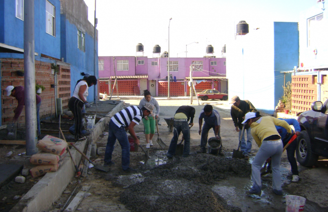 Community members participate in construction efforts (Photo courtesy of OPFVII)