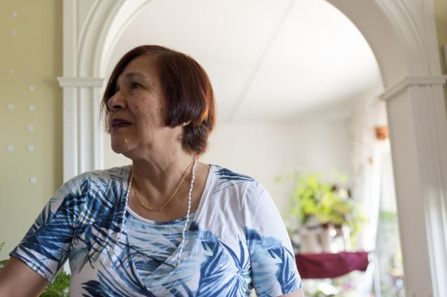 Raquel Martin, 72, talks in her apartment in Märsta, a suburb of Stockholm, Sweden. (Photo by Beatriz Sokol)