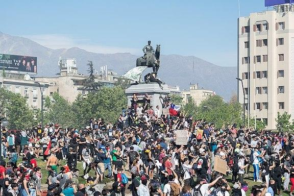 Protests in Santiago, Chile (Photo by Carlos Figueroa/Wikimedia)