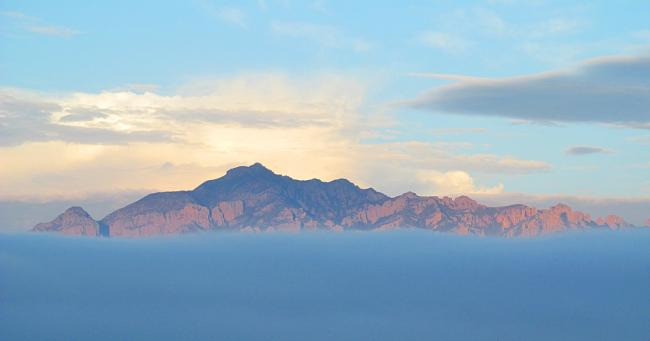 Portal Peak in the Chiricahua Mountains, one of the sky islands, surrounded by clouds. (Wikimedia Commons)