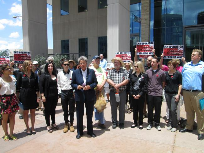 The defendants' lawyer, Margo Cowan, speaks outside the courthouse with Steve Johnston standing beside her (right). (Paige Winslett)
