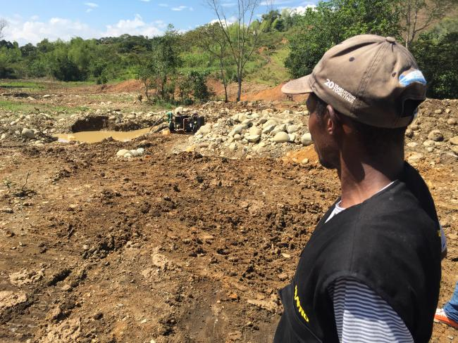 Surveying an area cleared for illegal mining in Cauca (Photo by Adriana Cardona-Maguigad)