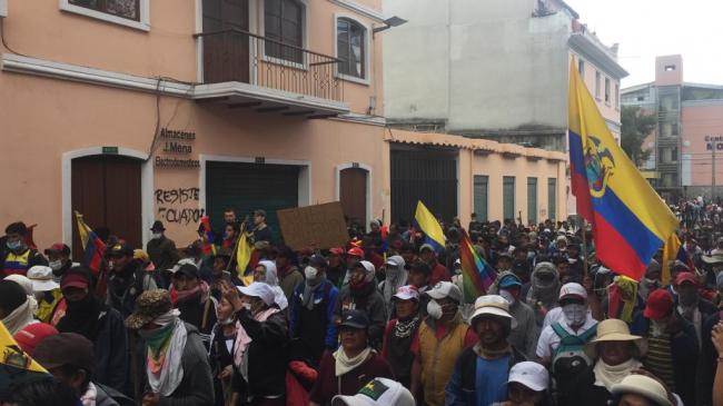 Demonstrators protest in central Quito against the government's decision to eliminate fuel subsidies. (Photo by Cloe Perol)