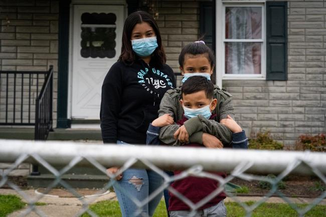 Frank stands with his sister Belsis, and aunt Cesia in front of their home just outside of Baltimore, MD. The family members migrated from Honduras and are awaiting legal protection (Daniel Zawodny)