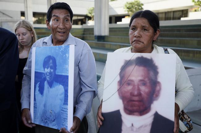 Plaintiffs at Goni's Trial in Fort Lauderdale, Florida hold posters of their family members who were killed at the hands of the state in the Bolivian Gas War in 2003. (Noah Friedman-Rudovsky)