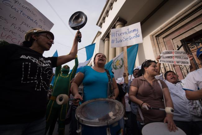 "Protesters in Guatemala rallied behind the mantra, ""Jimmy Goes, Ivan Stays!\"" (Santiago Billy/Comvite)"