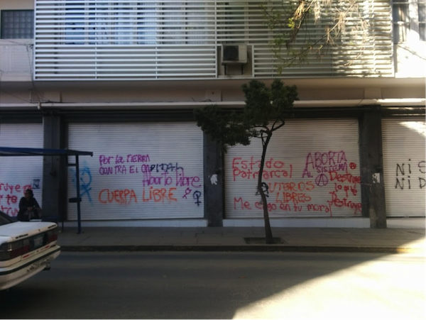 "Graffiti found in downtown Cochabamba, Bolivia. ""For the earth, against capital,"" ""Free abortion,"" ""Free body,"" ""Patriarchal state,"" ""Free uterus,"" ""I shit on your morals,"" ""Abort the system,"" ""Destroy what destroys."" (Photo by Jennifer Zelmer)"
