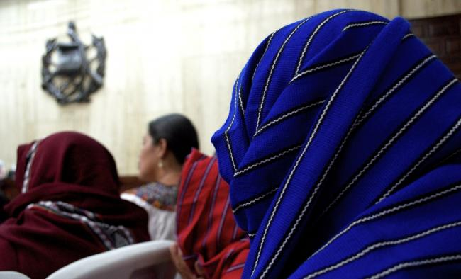The women of Sepur Zarco, forced into sex slavery at the hands of the Guatemalan military in 1982, listen to trial proceedings at the Guatemalan Supreme Court (Photo by Quimy de Leon)