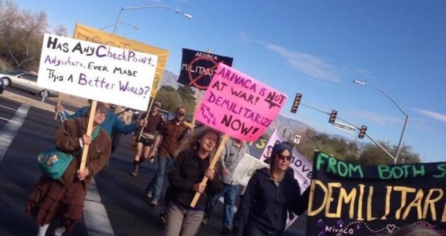 Residents of Arivaca, Arizona protest at one of the checkpoints that surrounds their town in 2013. (Photo by Geoff Boyce)