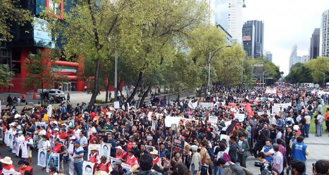 An estimated 30,000 people protested in Mexico City to commemorate the two year anniversary of the disappearance of the 43 Ayotzinapa students (Photo: Peace Brigades International)