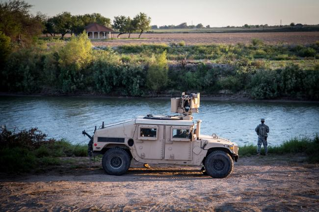 A soldier from the Texas Army National Guard observes a section of the Rio Grande River. (U.S. Army photo by Maj. Randall Stillinger, Flickr)