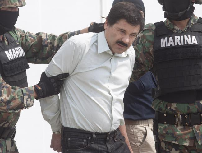 "Joaquín ""El Chapo"" Guzmán Loera detained in the Mazatlán Marina in February, 2014 (Rogelio A. Galaviz C./Flickr)."