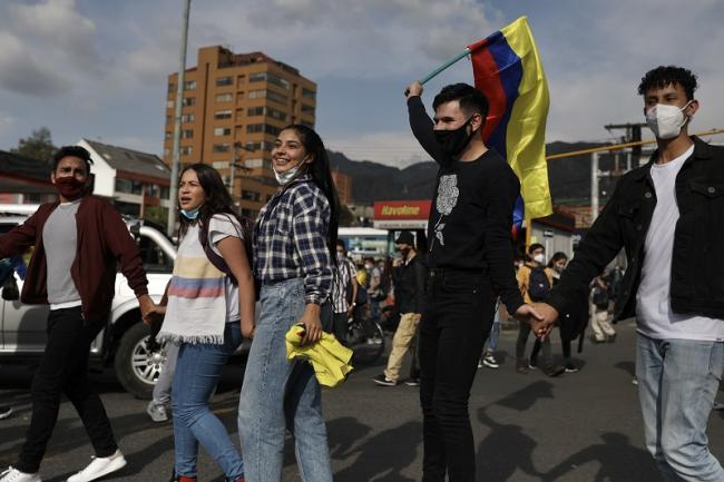 Protesters demonstrate at a peaceful roadblock in northern Bogotá, May 7, 2021. (Christina Noriega)