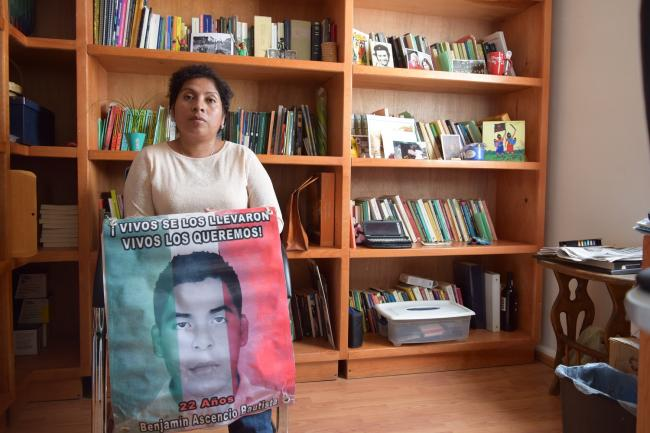 Cristina Bautista holds a photograph of her son, Benjamín, disappeared along with 42 others on Sept. 26, 2016 (Desinformemos)