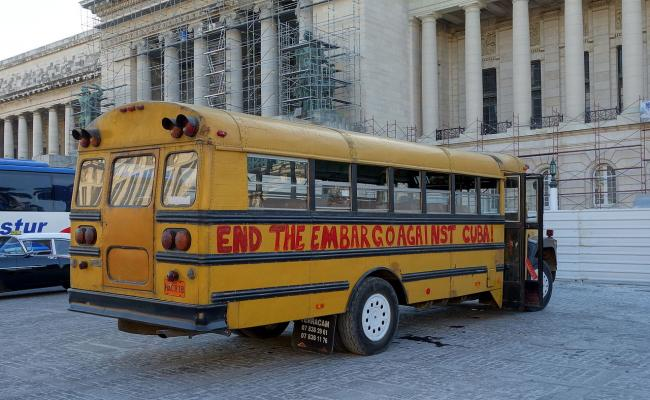 A school bus painted with a message protesting the U.S. embargo of Cuba. (Velvet, Wikimedia Commons)
