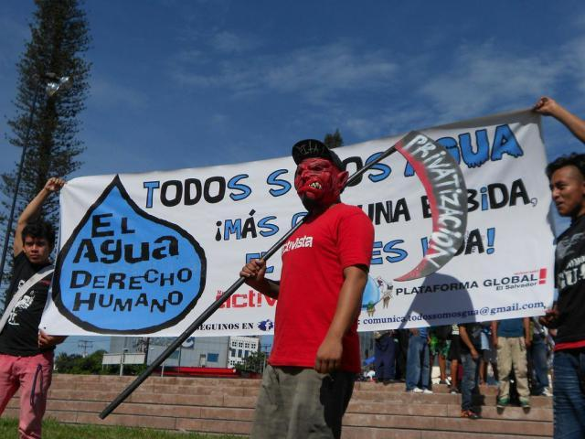 A protester at a march against the privatization of water in San Salvador (CISPES)