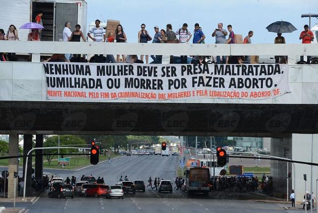 """A banner calling for legal abortion in Brazil reads """"No woman should be imprisoned, mistreated, humiliated, or die for having an abortion."""" (Agência Brasil, Wikimedia Commons)."""
