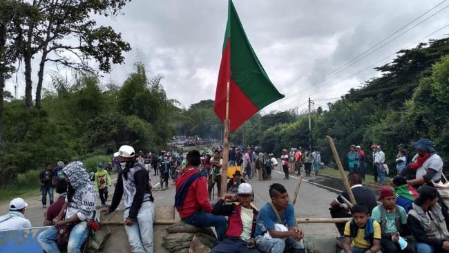 Minga protesters blocking a road. (Consejo Regional Indígena del Cauca CRIC)