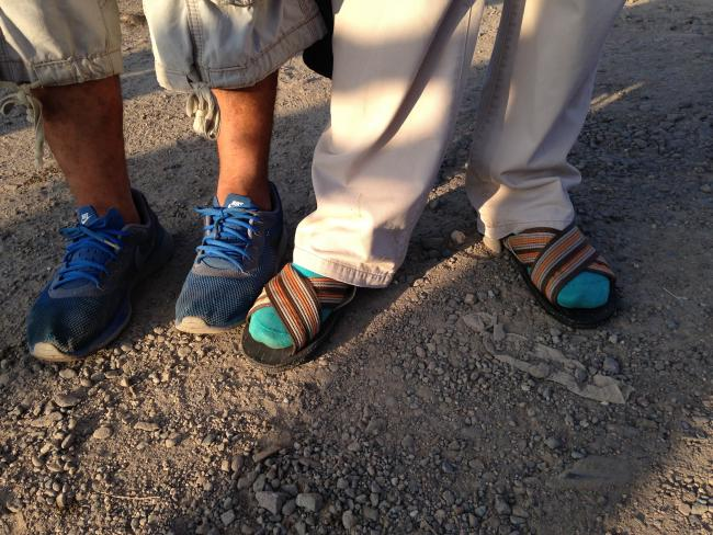 After giving away his sneakers to a migrant without shoes, the mayor of Zanatepec stands in socks and sandals. (Photo by Amelia Frank-Vitale)