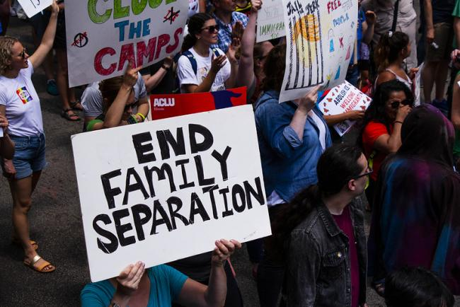 A protest against ICE and deportation raids in Chicago, Illinois in 2019 (Photo: Charles Edward Miller/Flickr)