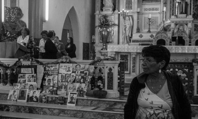 The women organized prayers and church services for the memory of their sons. They filled the altar with pictures. December 2019. (Photo by Francisco Sánchez).